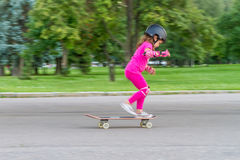 Young girl skateboarding Stock Images