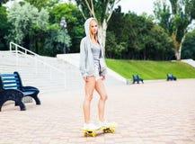 Young girl skateboarding Stock Photos