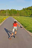 Young girl skating away Stock Photography