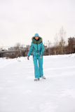 Young girl skating on the frozen lake Royalty Free Stock Images