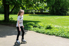 Young girl skating in park Royalty Free Stock Photo