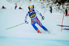 Young girl skier after finish spray of snow during Russian Cup in alpine skiing Royalty Free Stock Photos