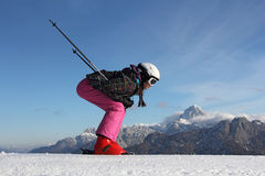 Young girl skiing. The young girl on skis in the background of mountains covered with snow Royalty Free Stock Image