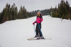 A young girl skiing in the mountains in Pylypets, in Transcarpat. Hia, Ukraine Royalty Free Stock Images