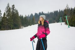 A young girl skiing in the mountains in Pylypets, in Transcarpat. Hia, Ukraine Royalty Free Stock Photography