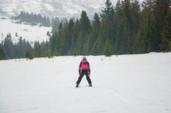 A young girl skiing in the mountains in Pylypets, in Transcarpat. Hia, Ukraine Royalty Free Stock Photos