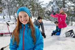 Girl on skiing with parents and brother Royalty Free Stock Photography