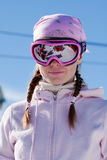 Young girl on skiing resort. Young girl in ski mask on winter sport resort in european mountains Stock Photography