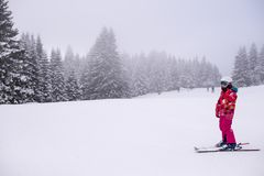 Little girl skiing. Young Girl skiing at a ski resort Stock Photos