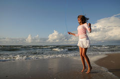 Young girl skipping on the beach Royalty Free Stock Photo