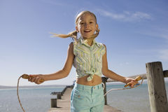 A young girl with a skipping rope Stock Images