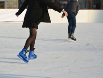 Young girl in skirt ice skating Stock Image