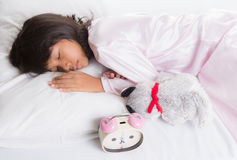 Young Girl Sleep With Alarm Clock III Stock Images