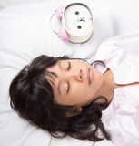 Young Girl Sleep With Alarm Clock XI Royalty Free Stock Photography