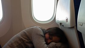 Young girl sleeping on airplane royalty free stock images
