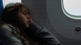 Young girl sleeping on airplane stock photography