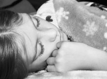 Young Girl Sleeping. A beautiful young girl sleeping peacefully royalty free stock images