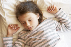 Young Girl Sleeping In Bed Royalty Free Stock Photo