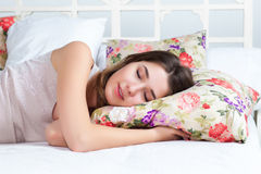 The young girl sleeping in bed Stock Images