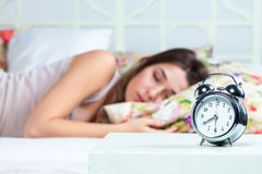 The young girl sleeping in bed Stock Photography