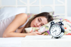 The young girl sleeping in bed Stock Image