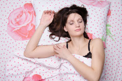Young girl sleeping in bed Stock Photo