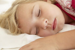 Young Girl Sleeping On Bed In Bedroom Stock Photo