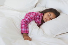 Young girl sleeping in bed at home Royalty Free Stock Images