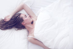 Young girl sleeping in bed Stock Photography