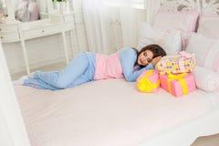 Young girl sleeping in bedroom Stock Photo