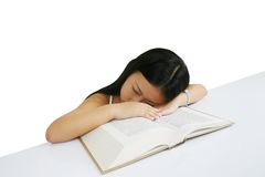 Young girl sleeping on a book stock images