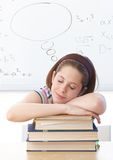 Young girl sleeping on books at school Stock Photo