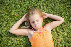 Young girl sleeping in park Stock Images
