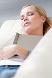 Young girl sleeps with book royalty free stock photography