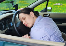 Young girl sleeps in her car. Royalty Free Stock Photo