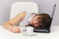 Young girl sleeps on laptop keyboard Royalty Free Stock Photos