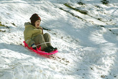 Young girl on a sleigh Stock Images