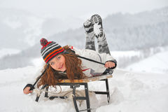 Young  girl on sleigh Stock Images
