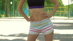 Young girl with slender bulge in shorts doing exercises on the streets. Athletic young girl with slender bulge in shorts doing exercises on the streets stock video footage