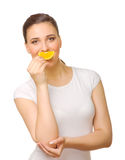 Young girl with slice of orange Stock Photo