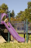 Young girl on slide Royalty Free Stock Photos
