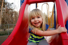 Young girl on slide Stock Images