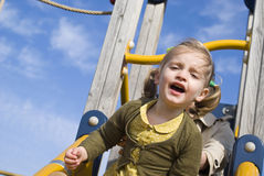 Young girl on slide in playground Royalty Free Stock Photography