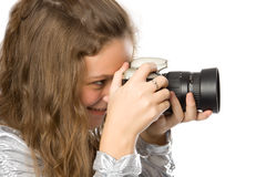 Young girl with SLR camera Stock Images