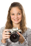 Young girl with SLR camera Royalty Free Stock Photo