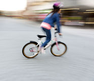 Young girl on small bike Stock Photography