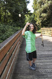 Young girl with Small Fish on Wooden Bridge Stock Image