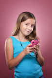 Young Girl With Smart Phone. A young girl listens to music on her smart phone Stock Photography