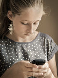 Young girl with smartphone Royalty Free Stock Photos