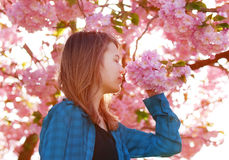 Young girl smelling blossoms Stock Image